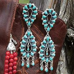TURQUOISE DOUBLE TIER EARRINGS  _  Two tiers of elegant turquoise stones surrounded by sterling silver. Post earrings.