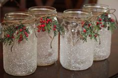 Beautiful Christmas/holiday themed mason jar candleholder. Clear jar is covered in clear diamond glitter giving it a sparkling frosty, icy look. It is accented with a sprig of festive holly berries.  This lovely candleholder will add a cozy warmth to any holiday décor. It looks perfect