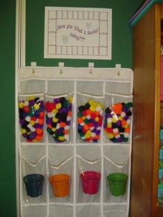 Have You Filled a Bucket Today?:  Buckets and Pompoms Using pompoms and buckets make the concept of kindness to others into something concrete young children can better understand.