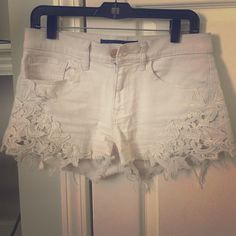 Jean shorts from Express Cream colored jean shorts with lace detail from express Express Shorts Jean Shorts
