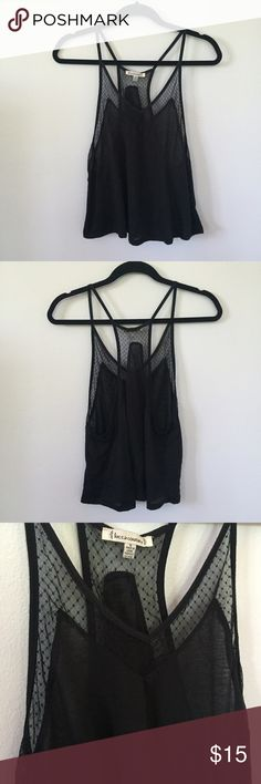 Black Polka Dot Mesh Tank Super cute light weight and flowy black tank from Urban Outfitters. Has super cute polka dot mesh detailing. Worn only one time and in excellent condition! ✨ Lucca Couture Tops Tank Tops