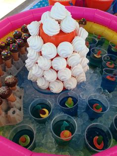 """Sweet treats at a mid-summer Pool Party - meringue 'Sand Castle"""", jelly babies swimming in a jelly pool, mini cake-pop ice creams."""