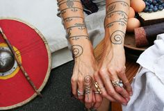 Real Viking Tattoos...neat. I Need to research if they are a female only tattoo like the Arab, Kurdish or Bedouin females. If not I'd totally do this.