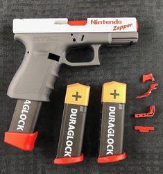 I don't always share Glock pics, but when I do, they're Nintendo Glocks. Weapons Guns, Airsoft Guns, Guns And Ammo, Zombie Weapons, Armas Airsoft, Tac Gear, Custom Guns, Cool Guns, Awesome Guns