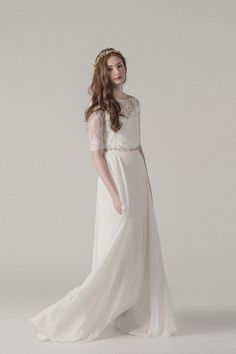 This never worn dress is the 2015 version of the Bleeker dress by Sarah Seven. The dress is beautiful, ethereal, and perfectly Bohemian.The dress is in 2 pieces, a slip silk in dress that lays of top
