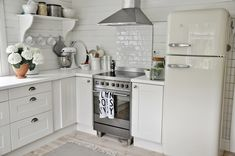 MARIAS VITA BO  --  cute cottage kitchen with a white SMEG refrigerator