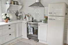 MARIAS VITA BO -- cute cottage kitchen with a white SMEG refrigerator