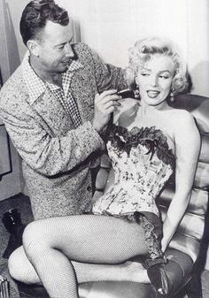 Marilyn Monroe getting touched up.