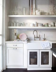 Consider Open Kitchen Shelves: Open kitchen shelves hold dishes for everyday use.