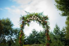 White & Gold Affair in Northfield | Minneapolis-St. Paul, MN | harvest greenery arbor with orange brown leaves | Sixpence Events & Planning Minneapolis Wedding Planner | Elliot Malcolm wedding photographer and videographer
