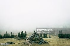 Stock Photo : Man Standing On Rock Formation During Foggy Weather