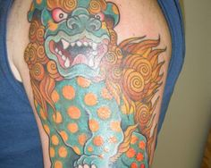 Colorful Angry Foo Dog With Dots On Body Tattoo On Left Half Sleeve