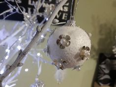 DIY Flower decor Christmas tree ornament from styrofoam ball and decorated with silver  stickers and white pearls .
