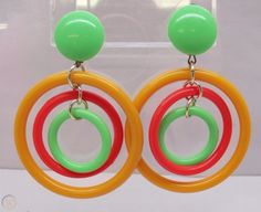 W Germany Plastic Dangle Earrings Mod Retro Yellow Orange Green Clip-ons Vtg-pair of vintage plastic dangle earrings- green, orangey/yellow and orange colors -aluminum metal findings connect the ho. Plastic Jewellery, Neon Jewelry, Plastic Earrings, Polymer Clay Earrings, Dangle Earrings, Mary Quant, Contemporary Jewellery, Clay Crafts, One Color