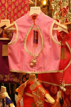 Sleeveless collar saree blouse idea. High neck in front, and a cute petal-shaped cut in the back.