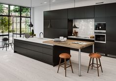Solid Surface and Laminate Kitchen Black Kitchens, Home Kitchens, Kitchen Dinning, Dining, Modern Kitchen Island, Serving Table, Cuisines Design, Apartment Kitchen, Beautiful Kitchens