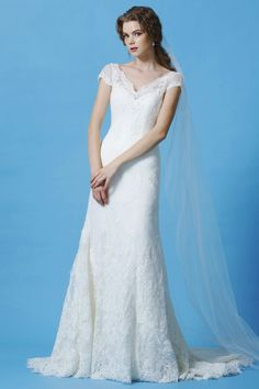 Romantic lace fit and flare with v-neck and cap sleeve wedding gown. Eden Bridal #BL036  Ivory Size 8. SALE $699, reg $1340