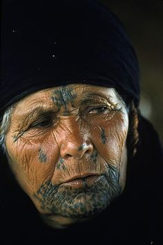 Bedouin tattoos. The sheikh's mother in The Desert Sheikh would have similar tattoos on her face