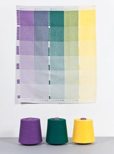 'index' (2012) looks at the technique of weaving, using three different color series to produce a collection of tea towels and blankets. each textile follows the same process from monotone, through duotone, to multitone, with the first shade taking the lead and a new tone will be added in the following step. these experiments have been translated into vertical panels, allowing the viewer to appreciate the different color combinations, that change depending on the compositional arrangements