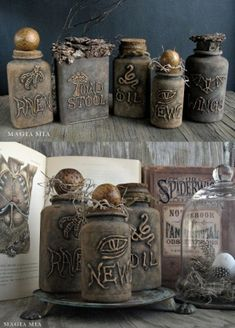 DIY:  Recycled Containers Get A Facelift For Halloween - this is an unbelievable transformation!!! The bottles are plastic vitamin bottles! The writing and designs are done with glue gun, paint and antiquing finish them off!
