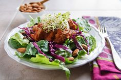 Pineapple-barbecued tofu is served over a mixture of spinach, romaine, and red cabbage lightly dressed with my Low-Fat Tahini Dressing and accompanied by raisins, raw almonds, and clover sprouts.