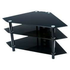 Walker Edison Glass and Metal Corner TV Stand, Black This contemporary TV stand offers a sleek modern design crafted with durable black metal tubing and Modern Corner Tv Stand, Black Corner Tv Stand, Entertainment Wall Units, Home Entertainment Furniture, Furniture Sale, Furniture Decor, Living Room Wall Units, Living Rooms, Tv Media Stands