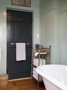 Love this towel rack and the door. Michelle Smith's Shingle Style cottage in Sag Harbor featured in Lonny Magazine