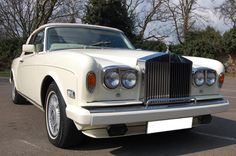 1980 W Rolls Royce Corniche Series II. Finished in Ivory with White hood that has been recently replaced with Magnolia interior piped in Walnut with Magnolia knee roll. Only 82,000 miles with Full Service History, known to ourselves for last seven years. Immaculate throughout and fast becoming a collectors car £52.950 Full Details:  http://hanwells.net/rolls-royce-select/corniche-selection/1980-w-rolls-royce-corniche-series-ii-in-ivory-52-950