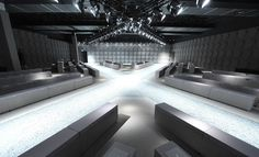 Z Zegna A cross-shaped catwalk was installed in the Z Zegna's Milanese headquarters, which carved out grey seating areas. Walls were paneled with three-dimensional reproductions of the house pentagram logo.