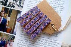 5 small wooden clothes pegs, covered in pink and blue washi tape. £2.50, via Etsy.