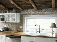white inset cabinets with pebble backsplash - traditional