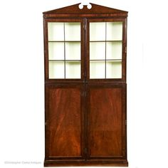 An exceptional, two-part, mahogany campaign Bookcase. The bookcase is made of both solid mahogany and veneer with pine used as the secondary timber. The doors to the deeper base section are panelled with the top section glazed. The interior o Painting Veneer, Stow On The Wold, Book Cabinet, Campaign Furniture, Wooden Bar, Off White Color, In The Heights, Pine, Bookcase