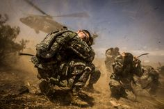 Soldiers assigned to the 3rd Squadron, 17th Regiment, are picked up by a Black Hawk helicopter after participating in a Survival, Evasion, Resistance, and Escape exercise at the National Training Center, Fort Irwin, CA, Aug. 13, 2014.