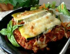 Ingredients: 2 1/2 cups zucchini, sliced  1/4 inch thick (about 2 medium) 1/2 lb lean ground beef (I use 1 lb.) 1/4 cup onion, chopped 2 small tomatoes, cut up 1 (6 ounce) can tomato paste 1 garlic clove, minced 1/2 teaspoon dried oregano 1/2 teaspoon dried basil 1/4 teaspoon dried thyme 1/4 cup water 1/8 teaspoon pepper 1 egg 3/4 cup low fat cottage cheese (or low fat or fat free ricotta) 1/2 cup mozzarella cheese, shredded (I use 8 oz. divided) 1 teaspoon flour  Directions: Cook zucchini…