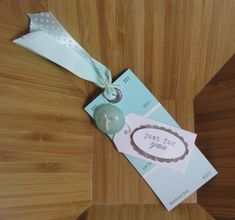 paint chip (note = free!!) gift cards.  punch hole, add ribbon, maybe embellish w/ beads or buttons .... endless possibilities