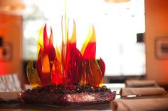 Fire Centerpieces - Take a cue from this Hunger Games bat mitzvah party and set your centerpieces on fire with fake flames. You could also add some real fire to the reception or bridal shower with fire pits or fire dancers!