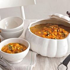 Pumpkin Chowder - Sautéed leeks, garlic, and bell peppers mingle in this satisfyingly chunky pumpkin chowder, which gets its heady aroma from marjoram and bay leaves.