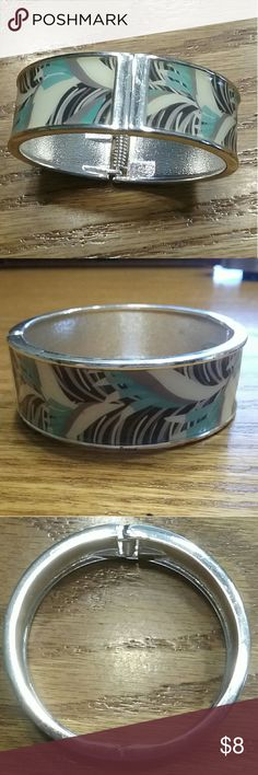 Light teal, cream and black bangle Opens and closes good Signs of wear, but nothing major Jewelry Bracelets
