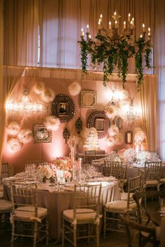 LOVE the unique pipe and draped wall with mirrors and paper flower balls. Gorgeous blush wedding! http://www.samuellippke.com/studio/index.html #cvlinens #wedding