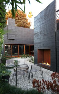 DWELL HOME VENICE: The gas burner in the outdoor fireplace from Spark Modern Fires looks amazing.