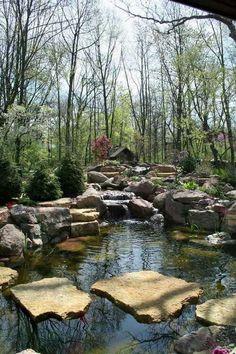 Fab pond framed by rocks ~