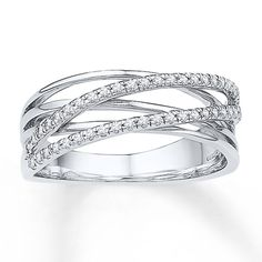 Ribbons of sterling silver criss-cross rows of sparkling diamonds to form this enchanting ring for her. The ring has a total diamond weight of carat. Diamond Total Carat Weight may range from - carats. Metal Jewelry, Gemstone Jewelry, Jewlery, Fine Jewelry, Plain Gold Bangles, Yellow Stone Rings, Middle Finger Ring, Agate Ring, Right Hand Rings