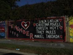 Street Graffiti wall: the memorial to the victims of gainesville's own serial killer, danny rolling (executed a few years back) Street Graffiti, Graffiti Wall, 34 Street, Gainesville Florida, My Town, Serial Killers, Gems, Memories