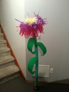 Tissue paper flower with pool noodle stem, poster board leaves and plunger stand. JOURNEY OFF THE MAP VBS 2015