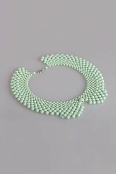 The necklace, featuring artificial plaited imitation pearls, collar shaped design, in a clasp fastening.$26