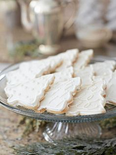 Serenely beautiful monochromatic decorated Christmas cookies from Midwest Living. Christmas #cookies #food #dessert #white #decorated #trees