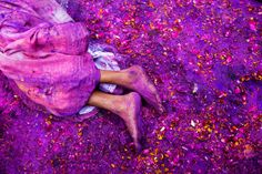 Widow lying on the ground during Holi in India