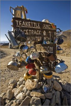 Death Valley National Park - Teakettle Junction sign loaded with tea kettles