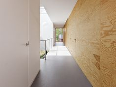 Home 09 is a minimalist house located in Holland, designed by Studio i29. The two-story residence uses a minimalist approach in both its construction and layout. Plywood is freely used throughout the interior as a tool to unite the spaces together. There are large panoramic windows that sprawl the perimeter of the home in order to extract as much natural lighting as possible. As a compliment to the plywood, black was used as a color for the furniture, fixtures, and other accents. (5)