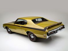 Buick GSX. I had a dream like this only in burnt orange with no spoiler or stripe. The ultimate sleeper.